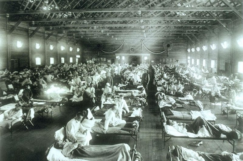 Historical photo of the 1918 Spanish influenza ward at Camp Funston, Kansas, showing the many patients ill with the flu. Circa December 1917. (U.S. Army photographer)