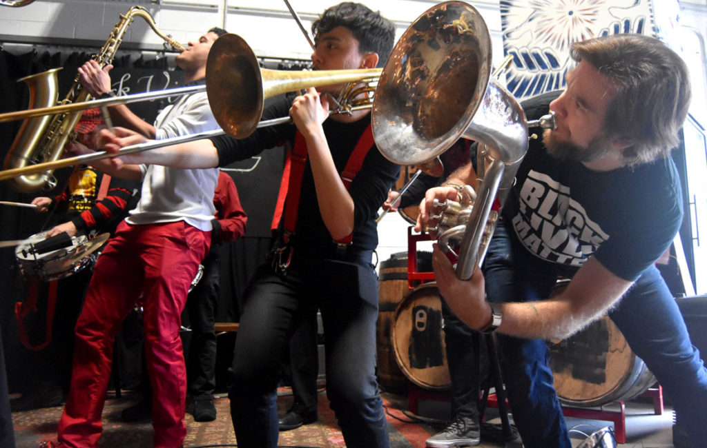 Second Line Social Aid and Pleasure Society Brass Band performs at the HONK! Festival 2017 Volunteer Appreciation Pizza Party at Aeronaut in Somerville, Feb. 18, 2018. (Greg Cook)