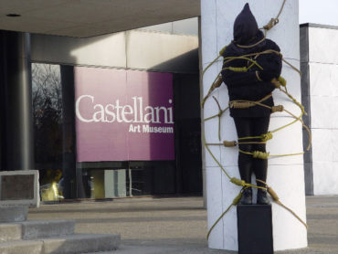 Ari's lynching performance at Niagara University's Castelliani Art Museum in the early 2000s. (Courtesy of the artist)