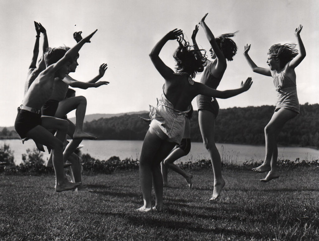 """Barbara Morgan, """"Children Dancing by Lake,"""" 1940, gelatin silver print, 13 ½ x 17 7/8 inches. (Courtesy of the Syracuse University Art Collection)"""
