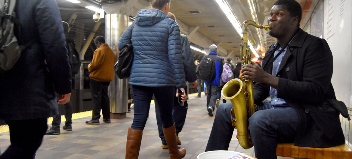 Musician performing in Downtown Crossing MBTA Station, Feb. 22, 2018. (Greg Cook)