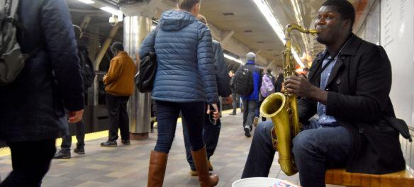 Musician performing in Downtown Crossing MBTA Station, Feb. 22, 2018. (Greg Cook)