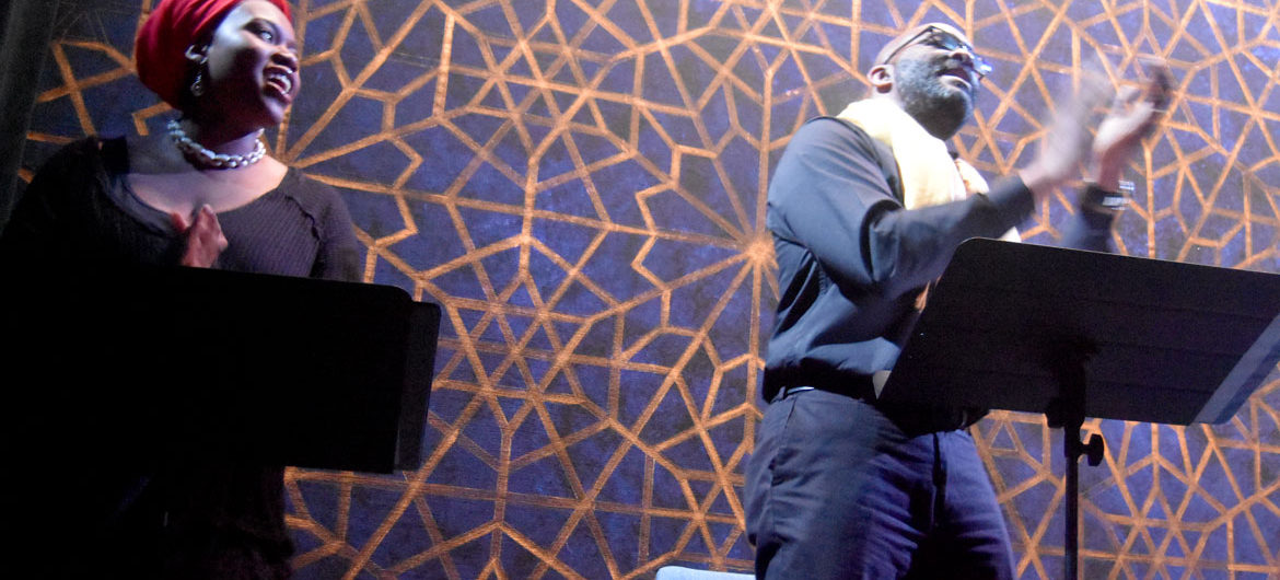 """Tenneh Silah (left) and Damon Singletary perform in Front Porch Arts Collective's """"A Wolf in Snakeskin Shoes"""" at Cambridge's Central Square Theater, March 19, 2018. (Greg Cook)"""
