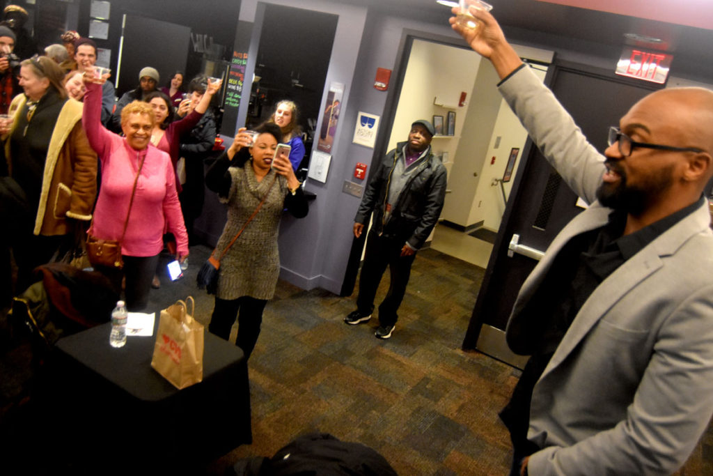 Front Porch Arts Collective Executive Director Maurice Emmanuel Parent leads a toast in the lobby of Cambridge's Central Square Theater, March 19, 2018. (Greg Cook)
