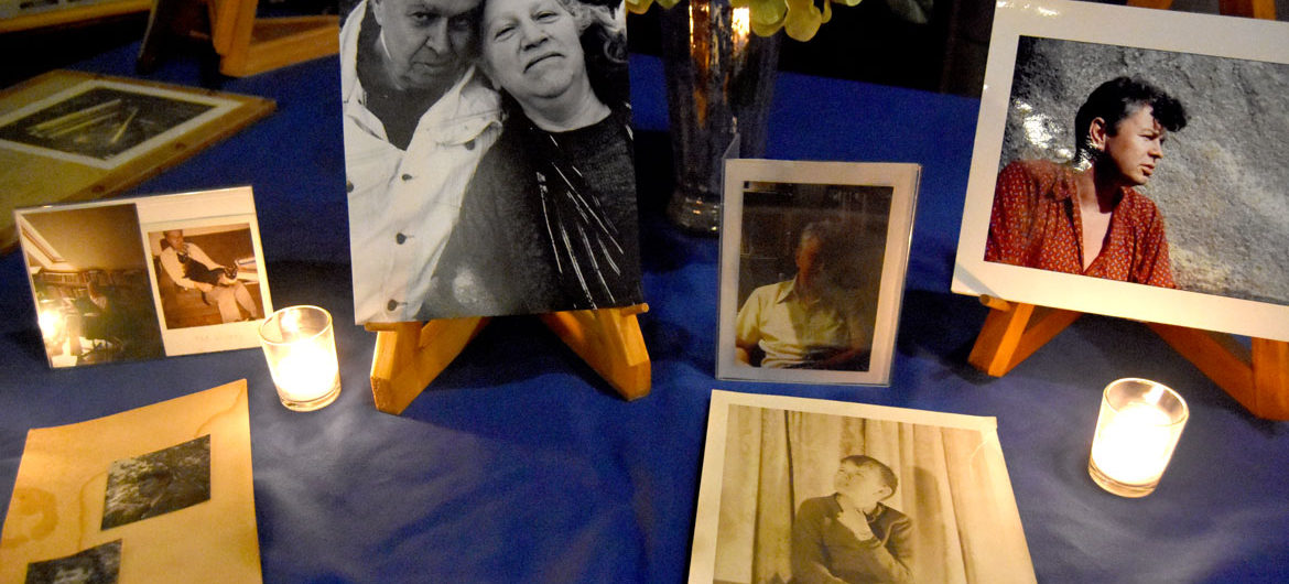 Photos of Gerrit Lansing displayed during the memorial for him at Gloucester's Hammond Castle, Feb. 24, 2018. (Greg Cook)