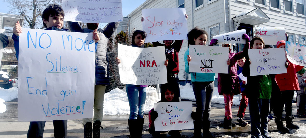 """""""No more silence, end gun violence!"""" Elementary students from Cambridgeport School protest guns on Broadway in Cambridge, March 15, 2018. (Greg Cook)"""