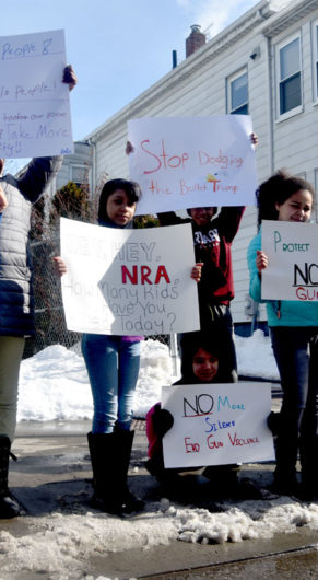 """No more silence, end gun violence!"" Elementary students from Cambridgeport School protest guns on Broadway in Cambridge, March 15, 2018. (Greg Cook)"