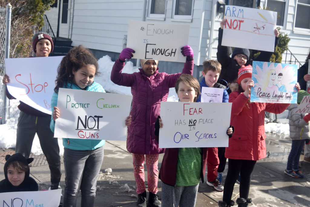 """Protect children not guns."" ""Fear has no place in our schools."" Elementary students from Cambridgeport School protest guns on Broadway in Cambridge, March 15, 2018. (Greg Cook)"