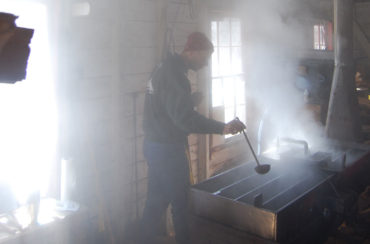Boiling maple sap down to syrup in the Ipswich River Wildlife Sanctuary sugar house in Topsfield, March 2014. (Greg Cook)