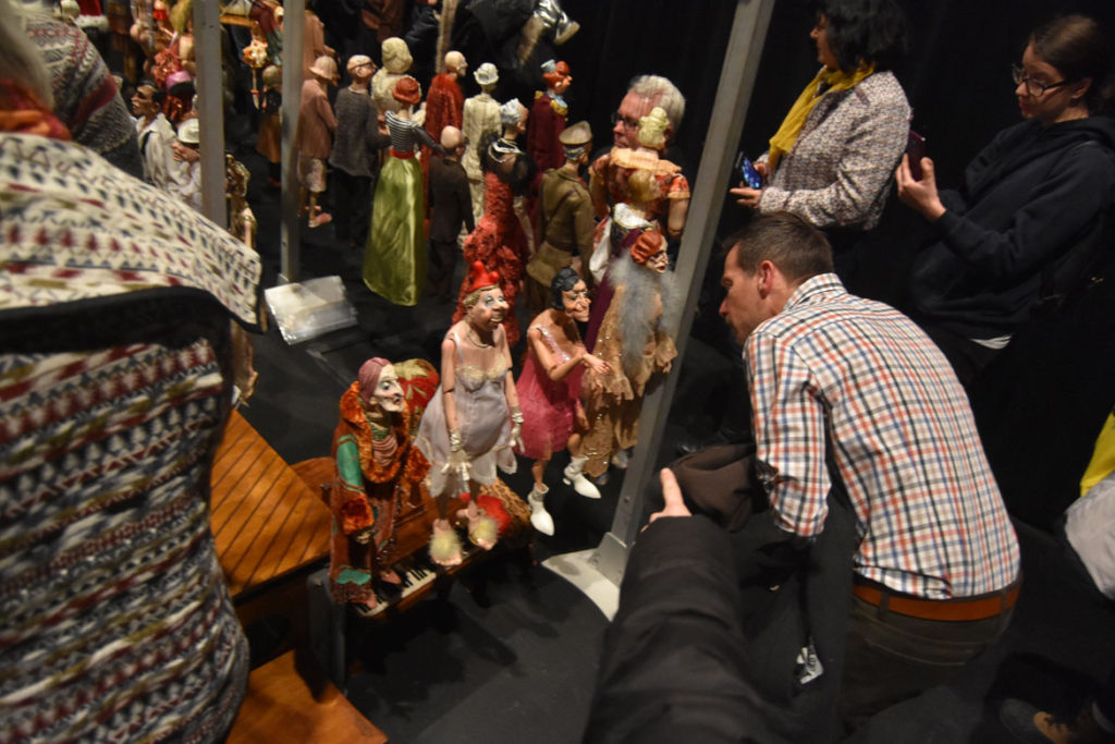 "Audience members examine the marionettes arrayed backstage for Ronnie Burkett's ""The Daisy Theater"" in Montreal, March 8, 2018. (Greg Cook)"