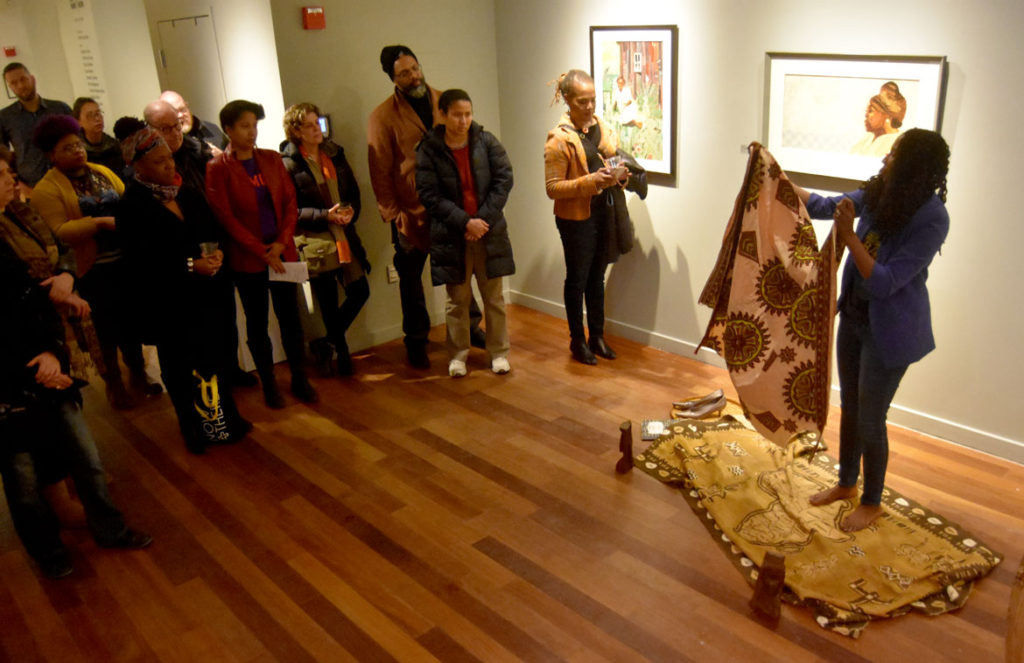 "Poet U-Meleni Mhlaba-Adebo performs at the opening reception for ""SayHerName: Watch Us WERK"" at Lesley University College of Art and Design's VanDernoot Gallery in Cambridge, March 29, 2018. (Greg Cook)"