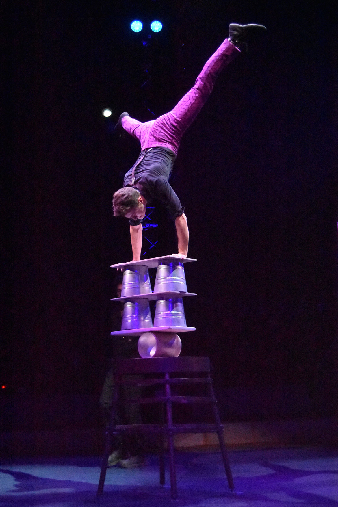 Jan Damm, who grew up in Maine, performs his Rola Bola (balance board) act during the Big Apple Circus. (Greg Cook)