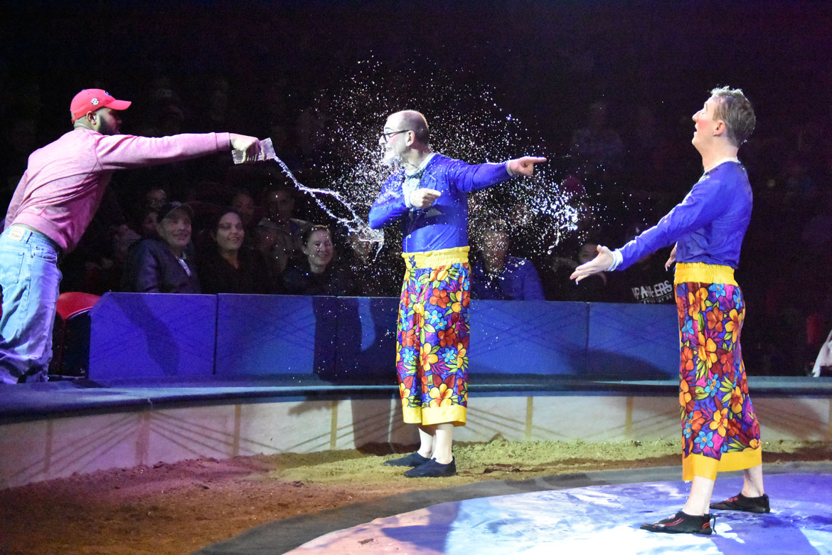 Clown Mr. Joel's—Joel Jeske (center)—attempt to get a Big Apple Circus audience member to soak his partner Brent McBeth doesn't work out in his favor. (Greg Cook)