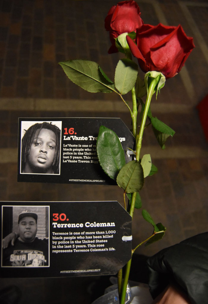 A couple of the roses Cedric Douglas handed out to remember more than 1,000 black people killed by police in the United States the past five years. April 27, 2018. (Greg Cook)