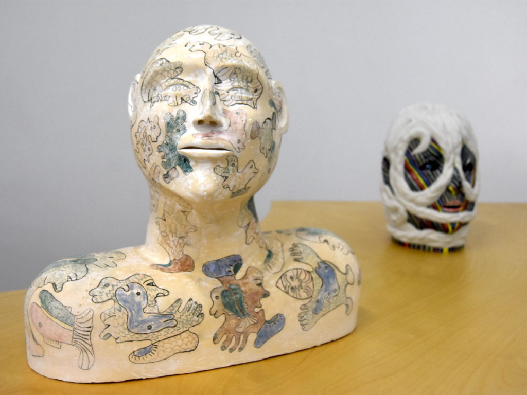 "Jessie Kenalogak and John Kurok ""Ceramic Bust with Drawings"" (left), stoneware with unerglaze pencils."