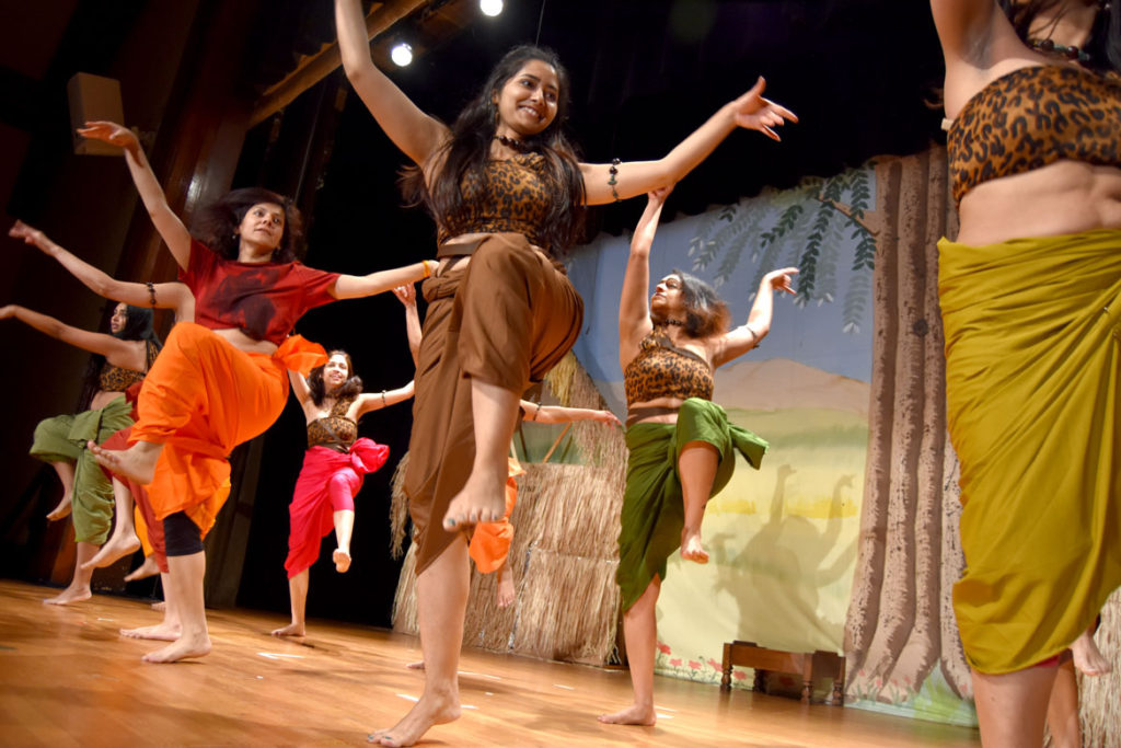 "Stage Ensemble Theater Unit (SETU) rehearses Girish Karnad's 1995 play ""The Fire and the Rain"" at Belmont Town Hall, April 26, 2018. (Greg Cook)"