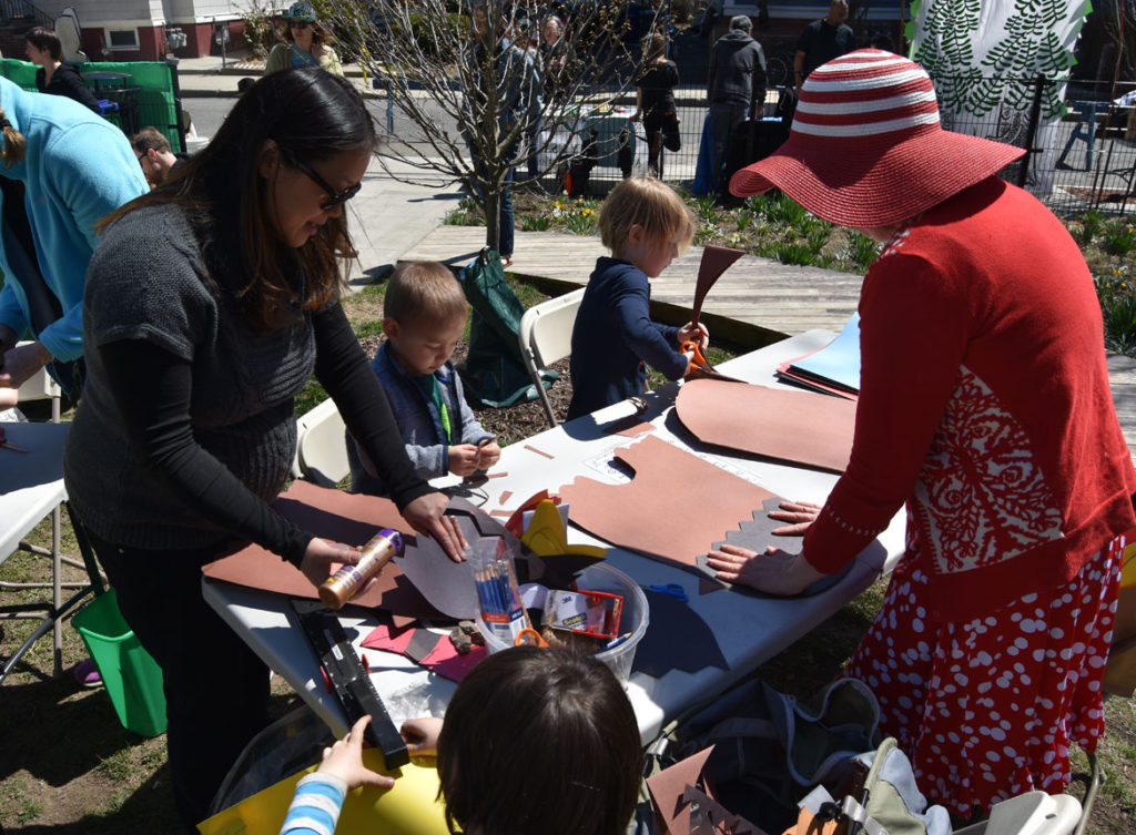 Making bird masks with artist Kari Percival (right) at the Starting Over Festival, Somerville, April 22, 2018. (Greg Cook)