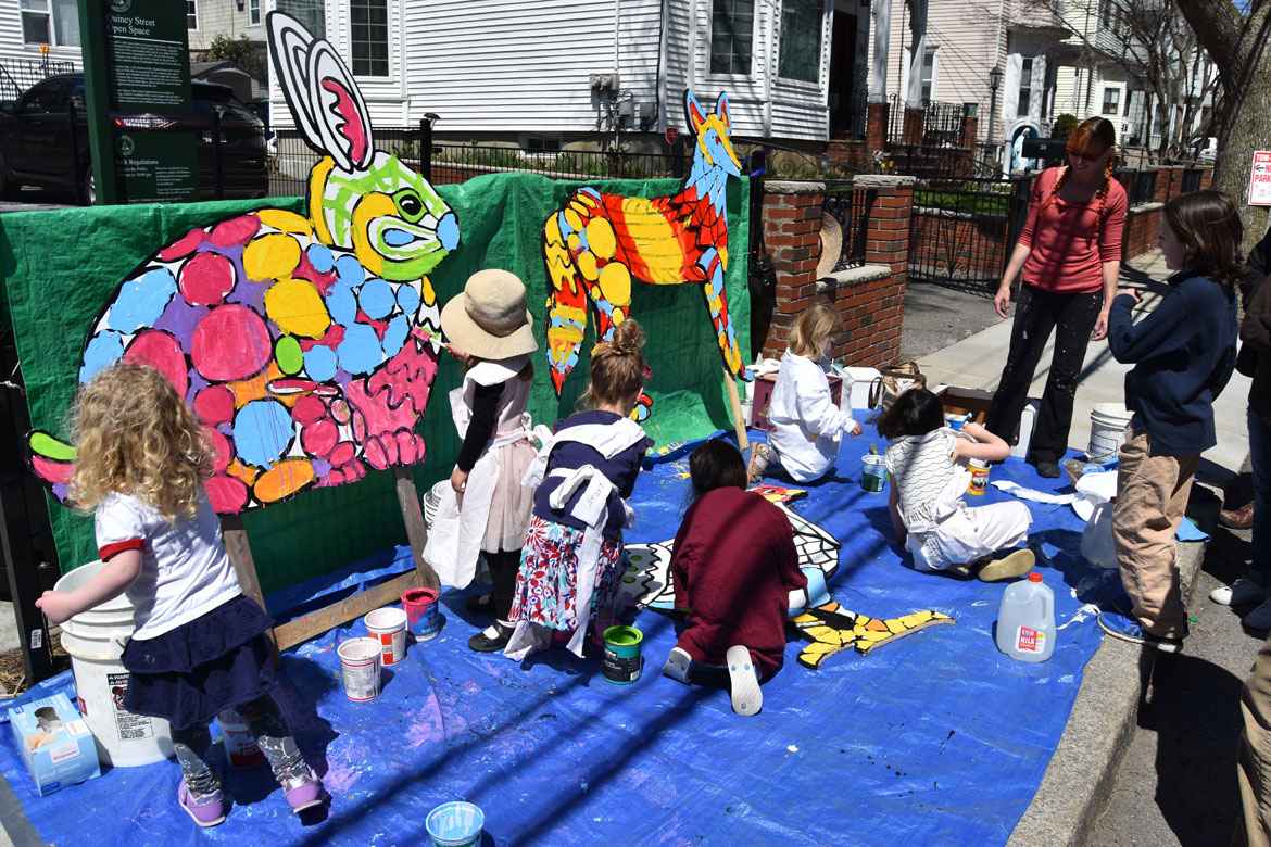 Painting mosaic-style animals designed by muralist Liz LaManche (in red at right) at the Starting Over Festival, Somerville, April 22, 2018. (Greg Cook)