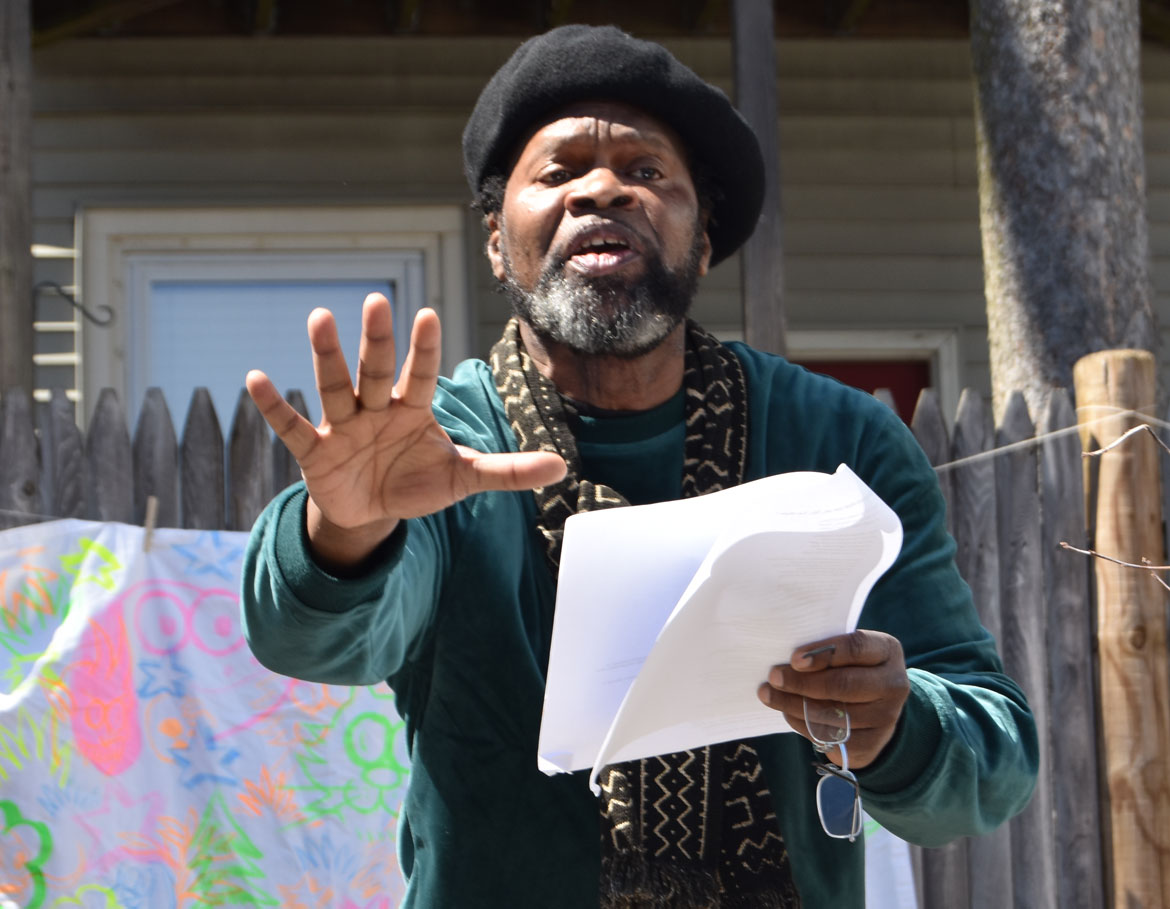 Eddy Toussaint Tontongi, a Haitian immigrant, read his poem responding to Donald Trump's insults of his homeland at the Starting Over Festival, Somerville, April 22, 2018. (Greg Cook)