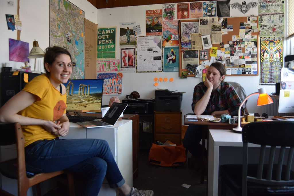 Emma Levitt (left) and Samuel Potrykus at the offices of the Boston Compass at Dorchester Art Project in Boston, May 2, 2018. (Greg Cook)