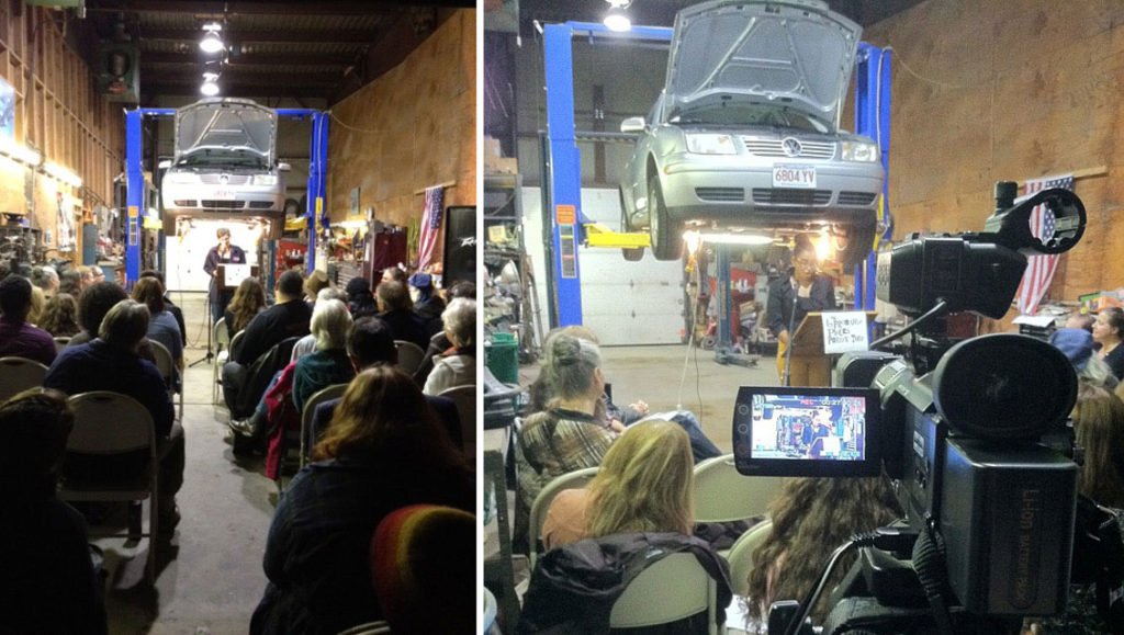 Reading in an auto shop during an Improbable Places Poetry Tour event. (courtesy)