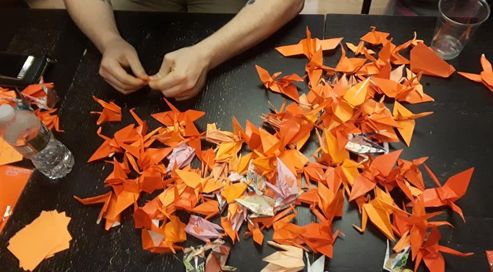 """Origami Crane Fold-In for Gun Violence Awareness"" at Pleasant Street Tea Co. in Gloucester, May 27, 2018. (Courtesy)"