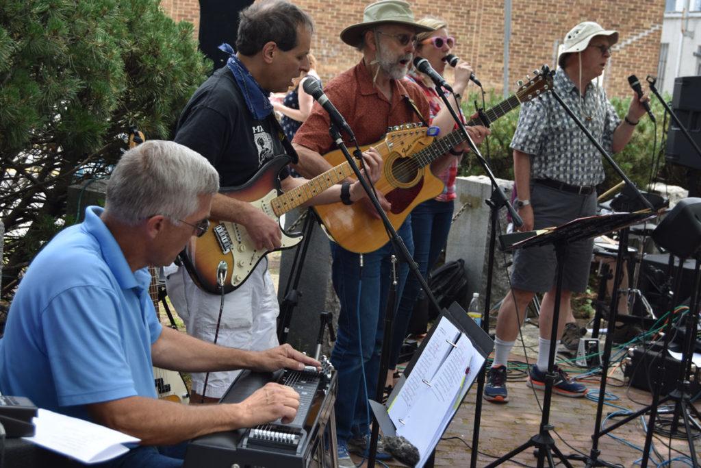 The Chameleons play at Arlington Porchfest, June 9, 2018. (Greg Cook)