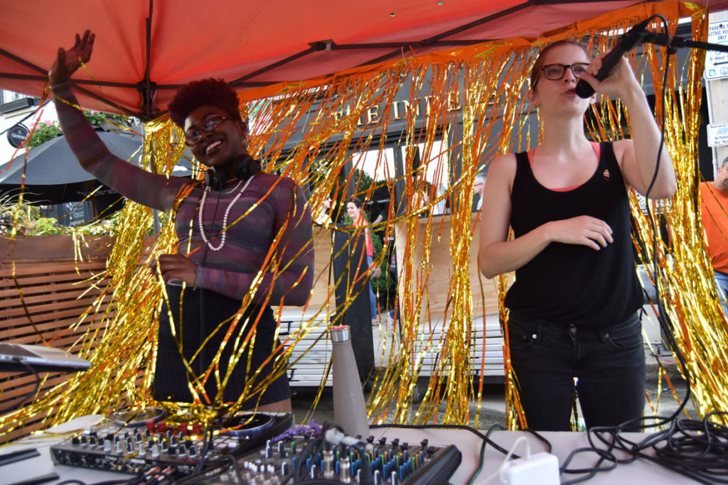 DJ Dee Diggs (left) and event organizer Nina Eichner of the Somerville Arts Council at the Big Gay Dance Party, June 2, 2018. (Greg Cook)