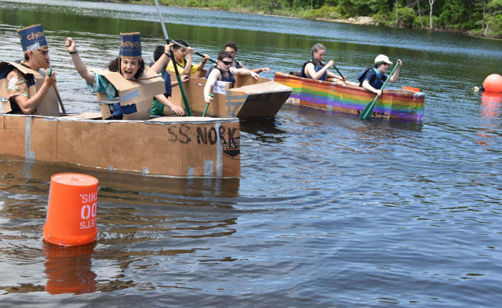 Bravado aboard the S.S. Nork at the Cardboard Canoe Races at at Wright's Pond in Medford, June 10, 2018. (Greg Cook)