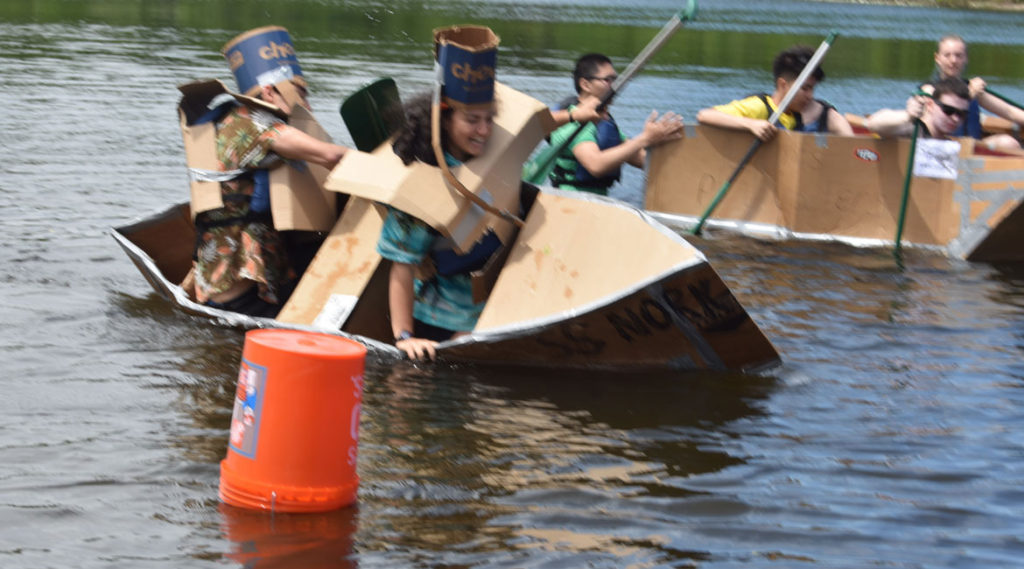 The S.S. Nork flips before the start of their heat during the Cardboard Canoe Races at at Wright's Pond in Medford, June 10, 2018. (Greg Cook)