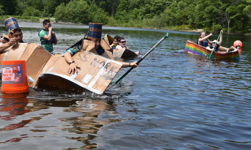 The S.S. Nork flips again during the Cardboard Canoe Races at at Wright's Pond in Medford, June 10, 2018. (Greg Cook)