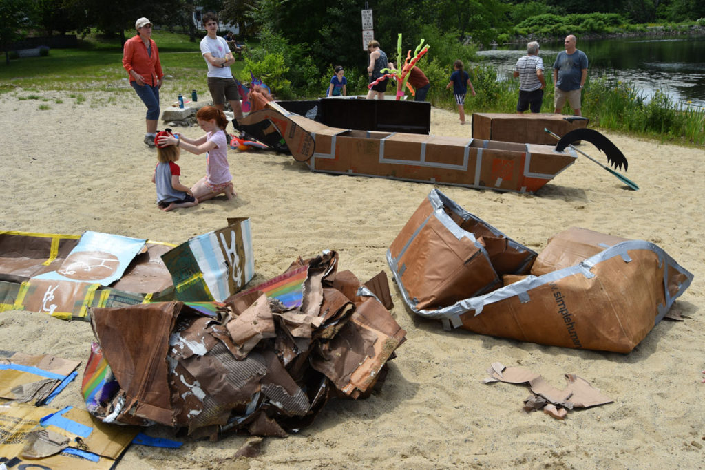 Wreckage after the first heats of the Cardboard Canoe Races at at Wright's Pond in Medford, June 10, 2018. (Greg Cook)