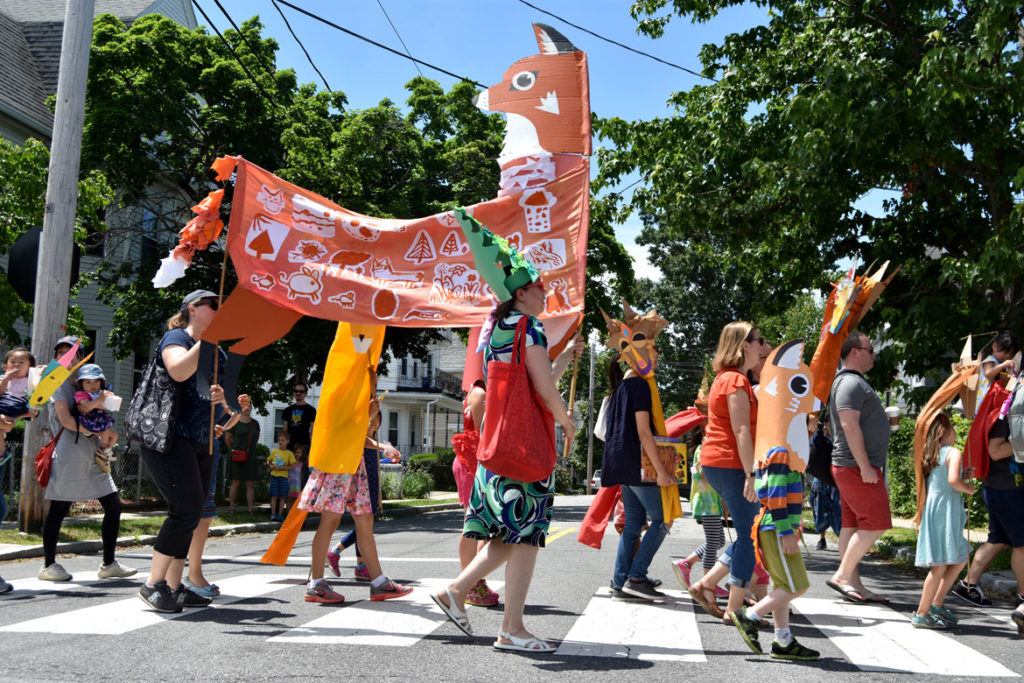 A giant fox puppet created by Wonderland Spectacle Co. (Kari Percival, Greg Cook) with help from local children in the Fox Festival Parade in Arlington, June 16, 2018. (Greg Cook)