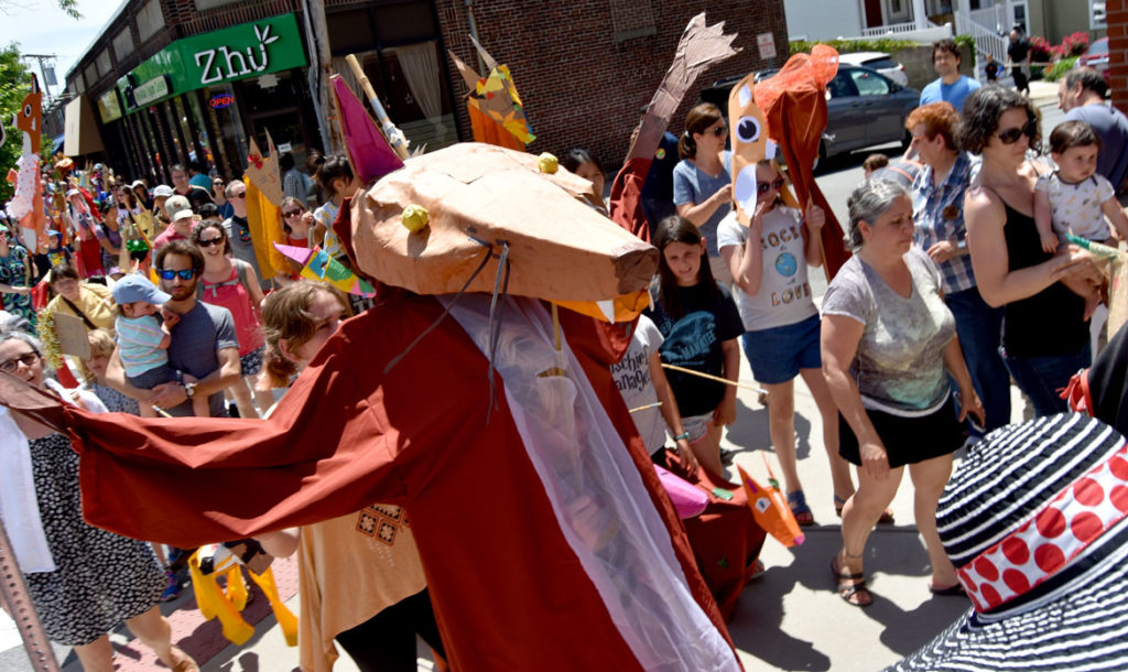 One of the giant fox puppets, created under the leadership of Sara Peattie of the Boston Puppeteers Cooperative, at the Fox Festival Parade in Arlington, June 16, 2018. (Greg Cook)