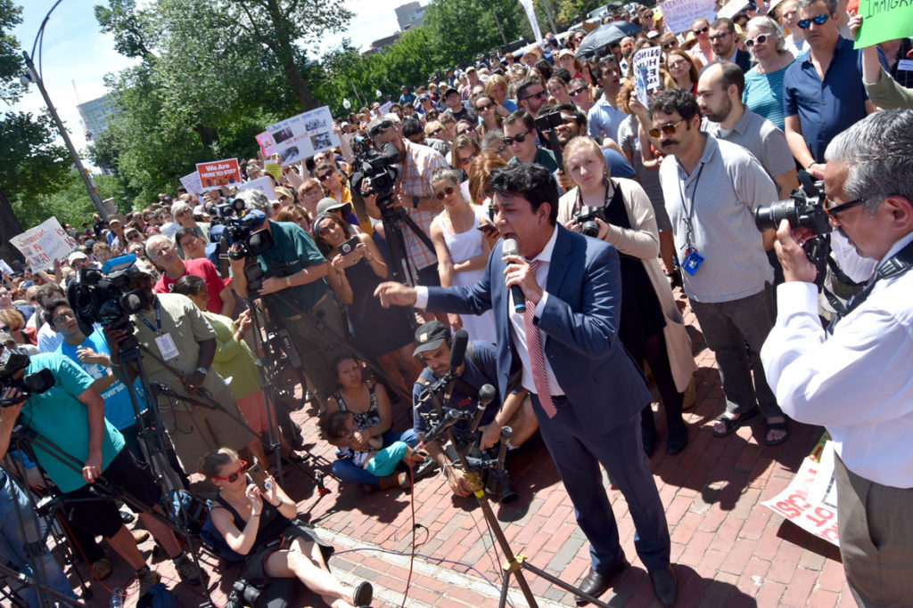 "Eduardo Samaniego speaks at the ""State House action to protect immigrant families in Massachusetts"" at Massachusetts State House, Boston, June 20, 2018. (Greg Cook)"