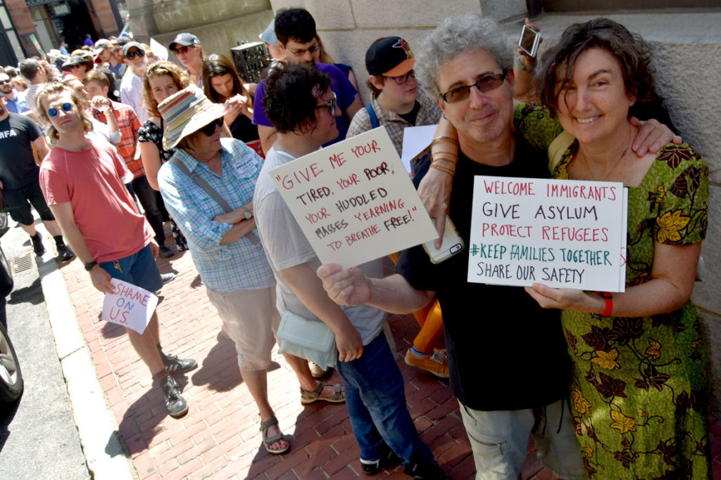 Protesters line up to enter Massachusetts State House in Boston to call on legislators to support undocumented immigrants. June 20, 2018. (Greg Cook)