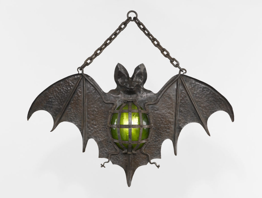 """Cabaret Sign, """"Bat,"""" France, possibly 19th century, modified in the 20th century. Wrought iron and rolled iron, carved and embossed, green glass,"""