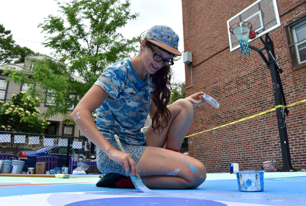"Maria Molteni paints her ""Storming the Court"" mural in Salem, June 13, 2018. (Greg Cook)"