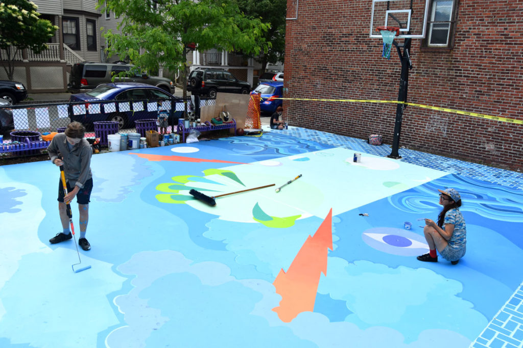 "Jena Tegeler (left) Maria Molteni and Kristine Roan (background) paint the ""Storming the Court"" mural in Salem, June 13, 2018. (Greg Cook)"