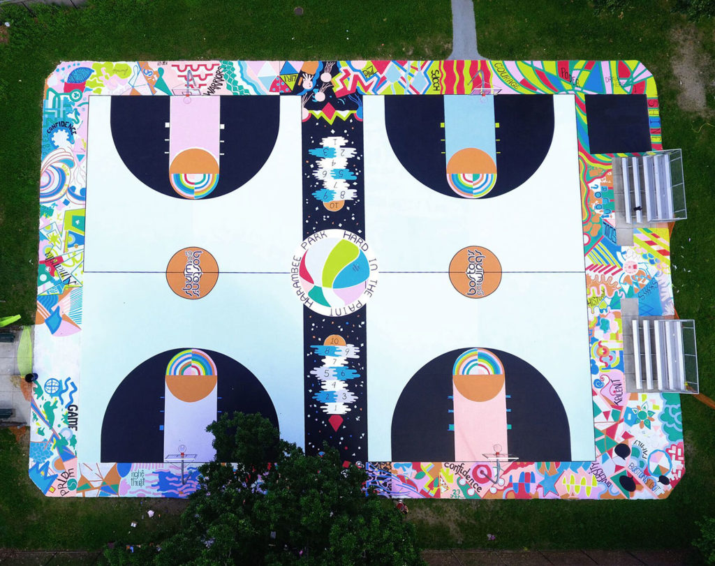 "Maria Molteni painted ""Hard in the Paint"" across two side-by-side basketball courts in Harambee Park outside the Perkins Community Center in Boston's Dorchester neighborhood during the summer of 2017. (Photo by Alan Shapiro)"