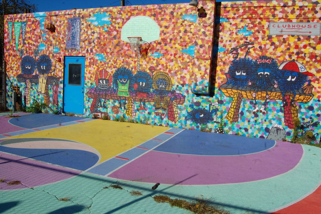 Maria Molteni's first basketball court mural at the (now defunct) art and sports Clubhouse at 471 Somerville Ave. in Somerville in 2016. Caleb Neelon painted the wall. (Greg Cook)