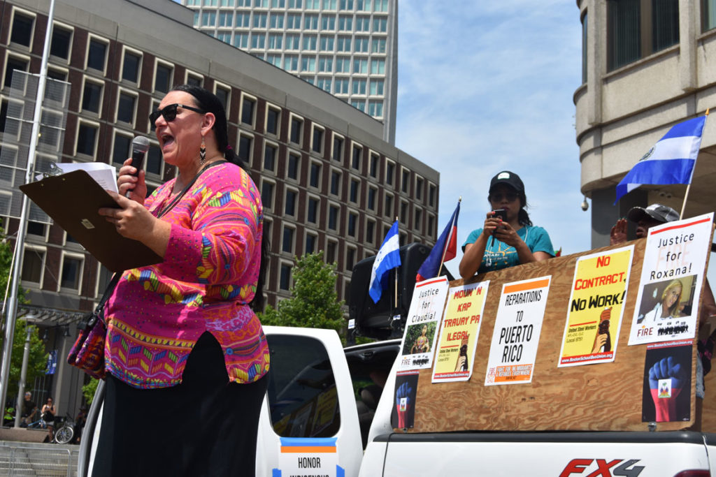 "Mahtowin Monroe of United Indians of New England speaks at ""Together and Free: Rally Against Family Separation"" at Boston City Hall, June 30, 2018. (Greg Cook)"