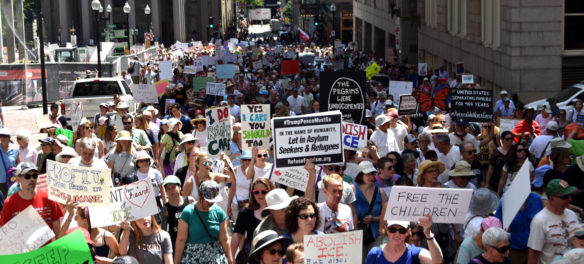 """Together and Free: Rally Against Family Separation"" marches from Boston City Hall to Boston Common, June 30, 2018. (Greg Cook)"
