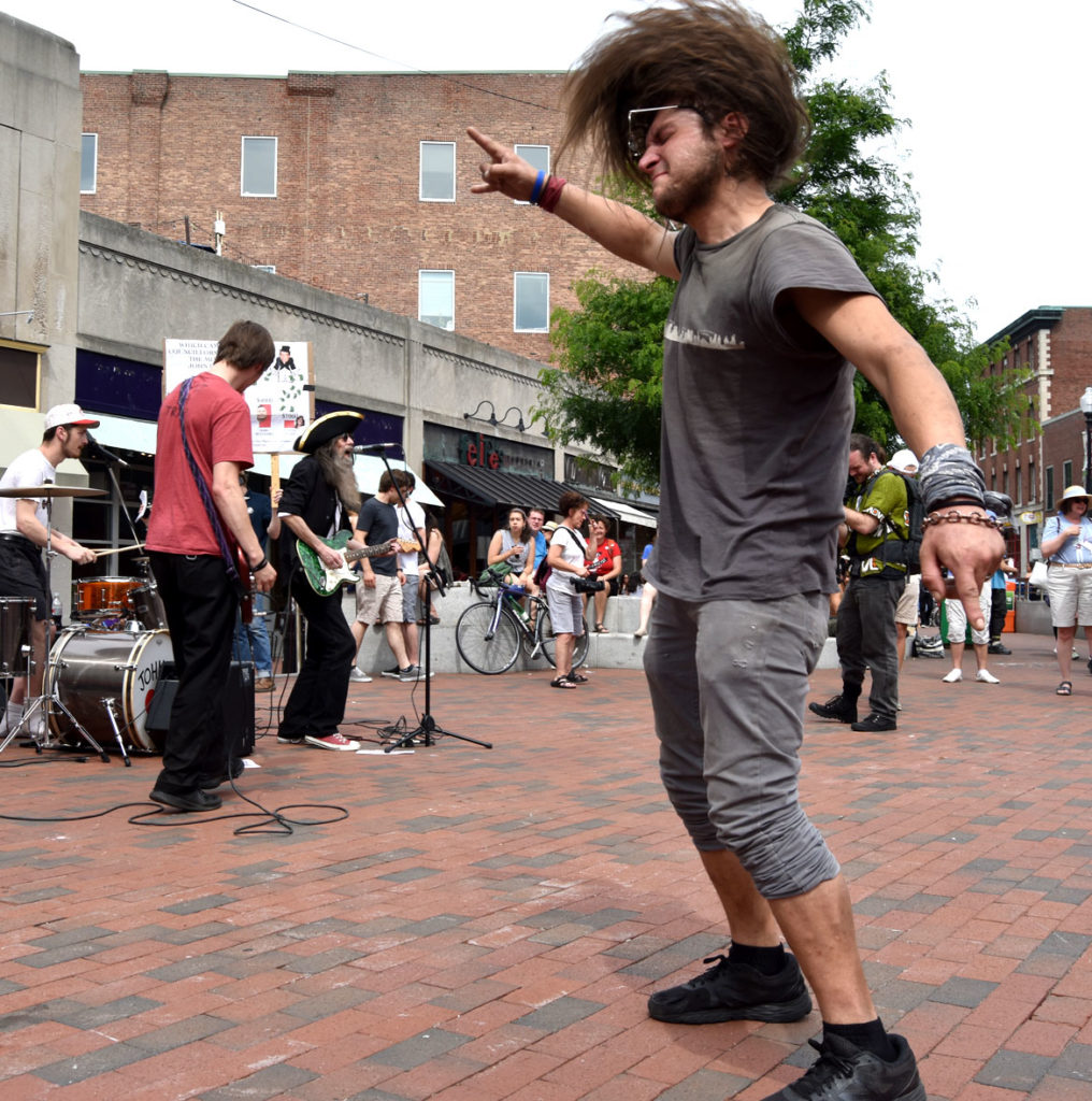 "Dancing as the Jonee Earthquake Band plays at the ""Save EMF"" rally in Harvard Square, Cambridge, June 16, 2018. (Greg Cook)"