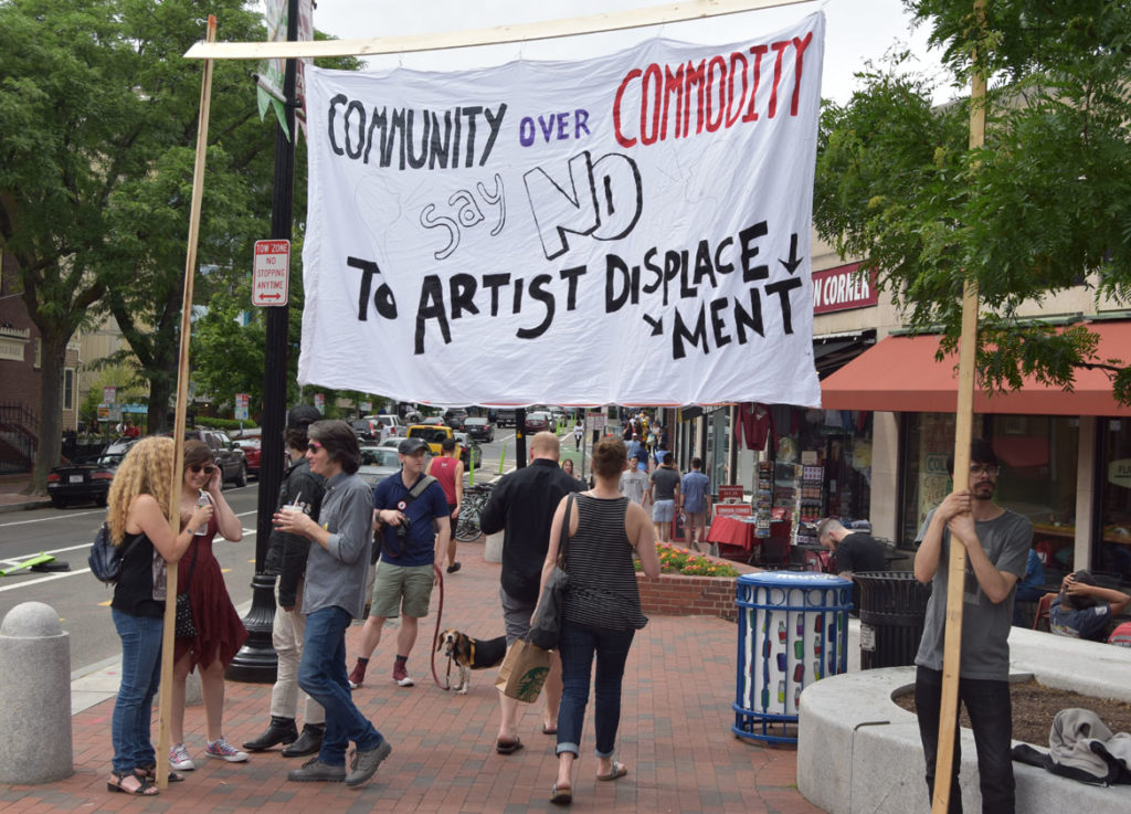"""Save EMF"" rally in Harvard Square, Cambridge, June 16, 2018. (Greg Cook)"