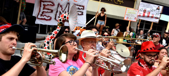 "Second Line Social Aid & Pleasure Society Brass Band plays at the ""Save EMF"" rally in Harvard Square, Cambridge, June 16, 2018. (Greg Cook)"