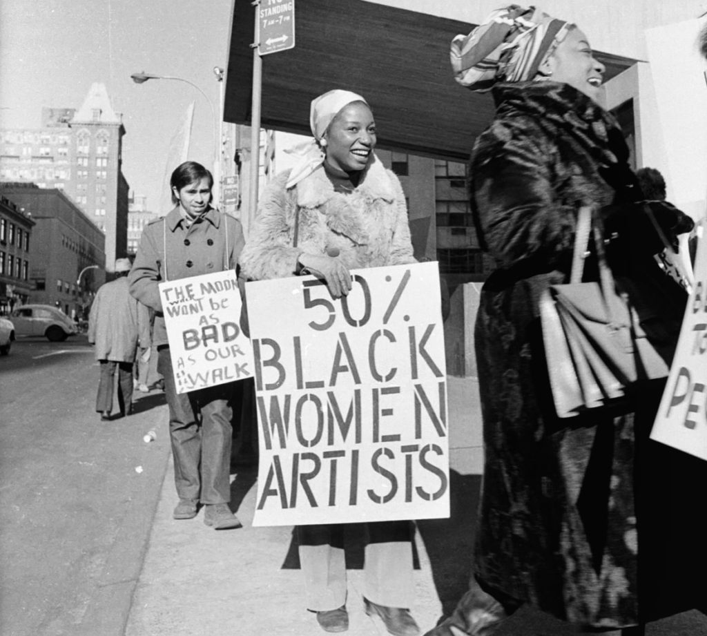 """Jan van Raay, """"Faith Ringgold (right) and Michele Wallace (middle) at Art Workers Coalition Protest, Whitney Museum,"""" 1971. (© Jan van Raay)"""