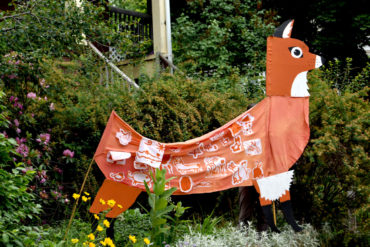 Fox puppet by Wonderland Spectacle Co. (designed by Kari Percival) for Arlington's Fox Festival Parade, June 15, 2018. (Greg Cook)