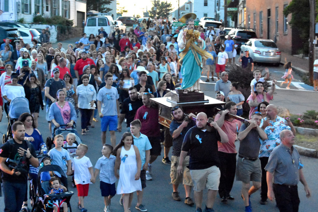 Procession through Gloucester's streets at the end of the Novena (nine days of prayer) that serve as a prelude to the St. Peter's Fiesta, June 26, 2018. (Greg Cook)