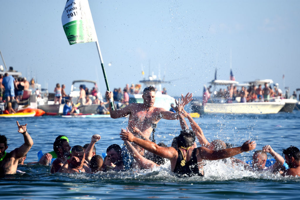 Frank Taormina is carried to Pavilion Beach by fellow Greasy Pole walkers after winning the contest, June 29, 2018. (Greg Cook)
